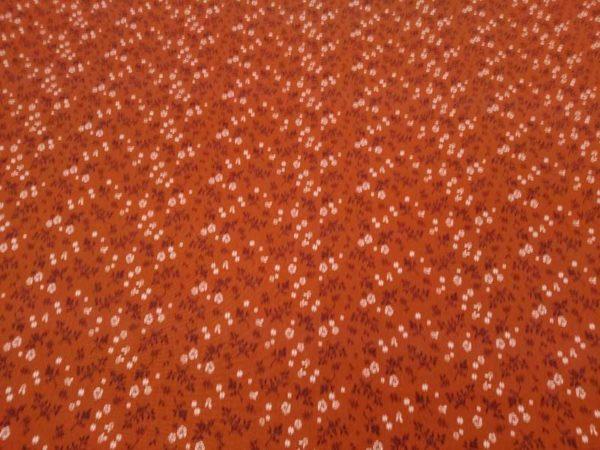 Tela de flores color teja