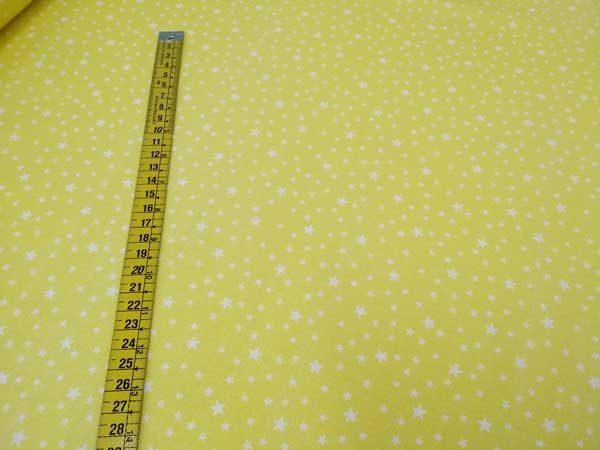 Tela de estrellas de fondo color amarillo pastel