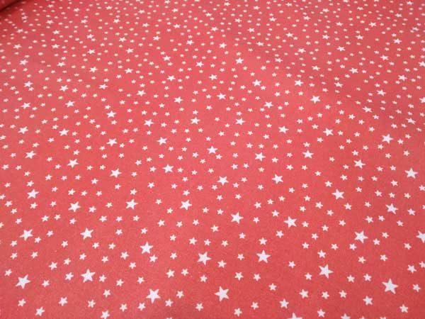 Tela de estrellas de fondo color coral