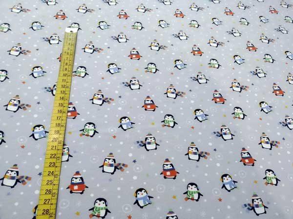 Tela Pingüinos fondo gris. Punto de camiseta.